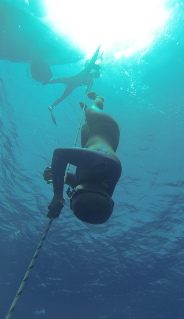 Freediving down during training coaching distance