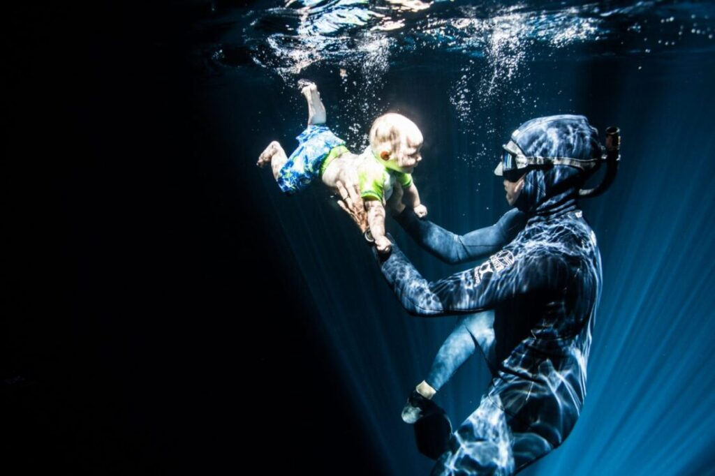 Baby freediving cenotes clear water light beams