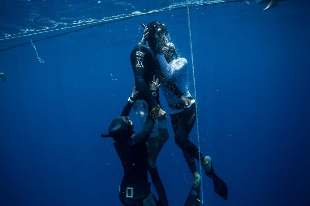 Safety divers evacuate freediver clear blue water