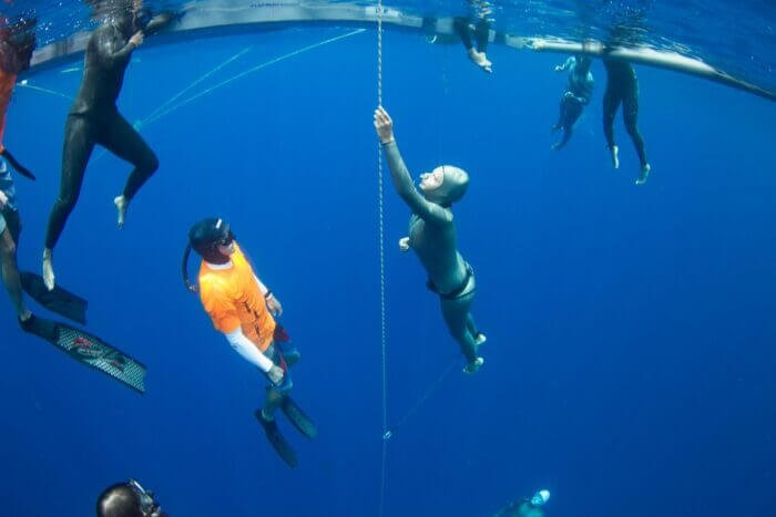 Ren and Ashley Chapman ascending from depth bonaire FIM national record 84m